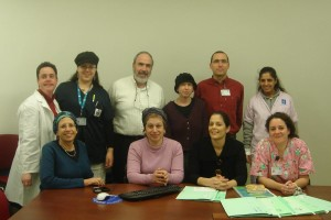 Shunamit left standing, at Hadassah hospital with staff